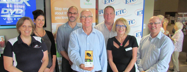 Ian Kinning holding his product in ETC foyer with ETC staff