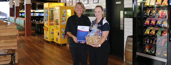 Toormina Hotel manager Pearl Beynon receiving ETC's Employer of the Month certificate and gift hamper from ETC Business Relationship Advisor Trinette McPhee