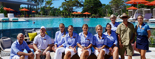 Elements staff sitting beside the pool at the recently opened resort