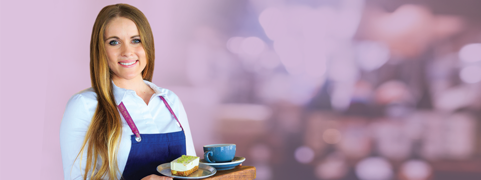 waitress holding food and a coffee smiling
