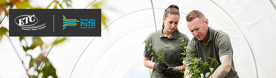Image of female PaTH participant and male employer in a green house