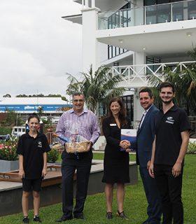 ETC staff awarding the Sails team