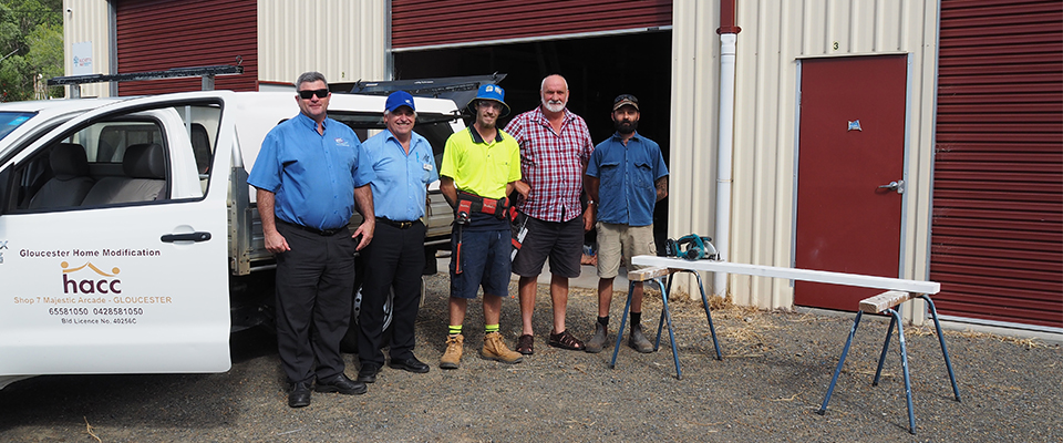 ETC staff and the Gloucester Home Modification tradies standing outside their workshop