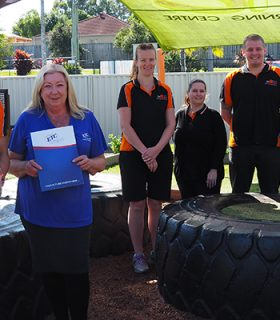 Far left is Justin Zulamoski and next to him is ETC Business Relationship Support Kerri Cowan, standing behind them is staff from the Busy Bees Academy
