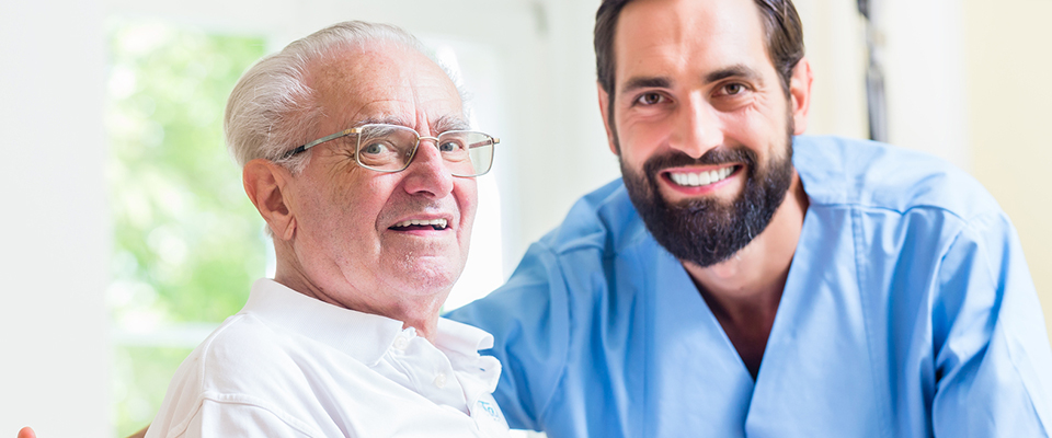 aged care worker with an elderly man