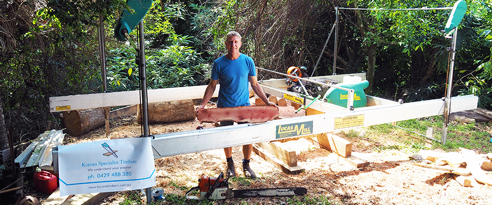 Ken holding a plank of timber at his sawmill