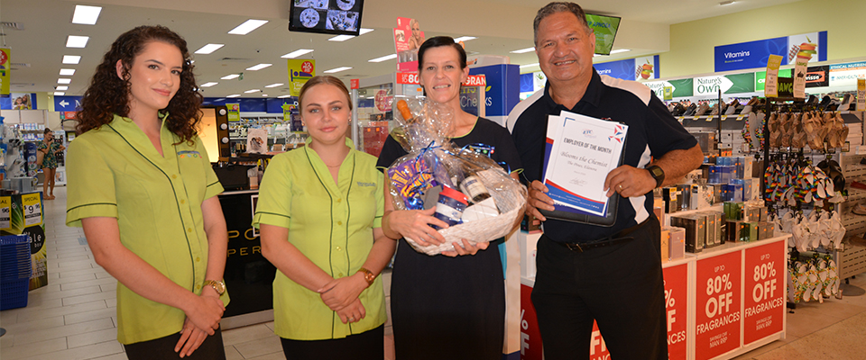 ETC staff awarding the hamper and certificate to Blooms the Chemist
