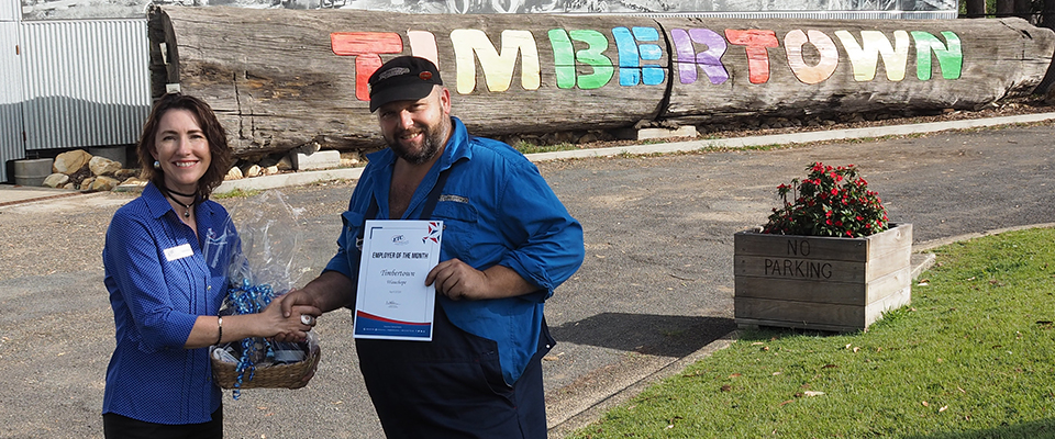 ETC Business Relationship Advisor Gabrielle Campbell, Timbertown Park Custodian David Waite receiving his Employer of the Month certificate and hamper