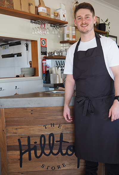 Nicholas Delves Apprentice Chef standing in from of cafe