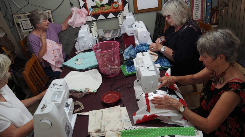 Boomerang Bags volunteers sewing