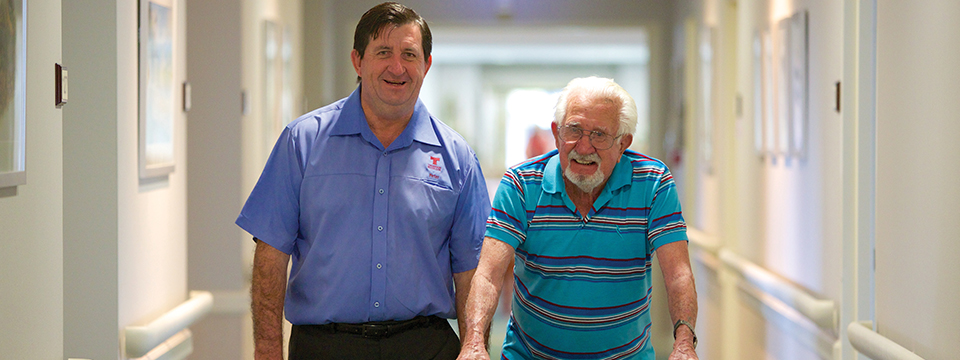 Man helping man in Aged Care home