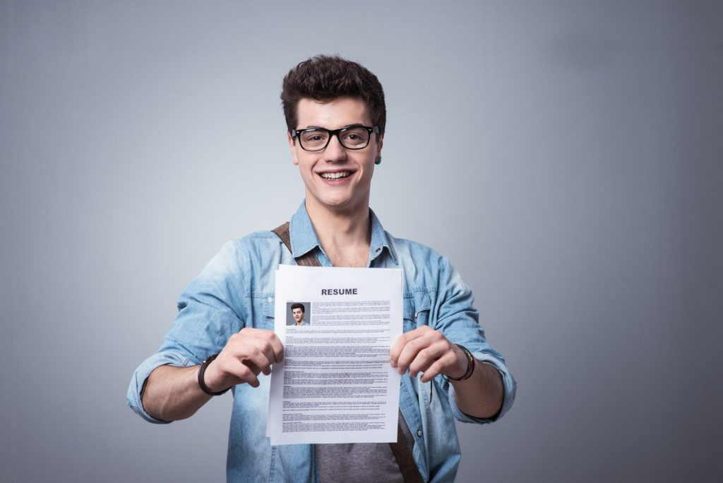 Young man holding a resume