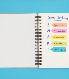 A note book with smart goals written on it