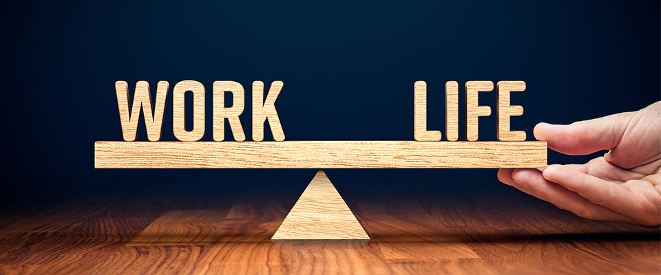 The words Work Life balance on a seesaw