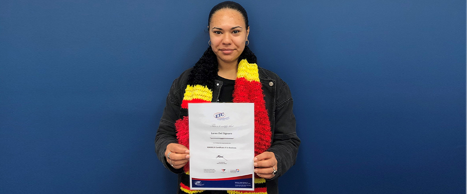 Transition to work customer Loren Del Signore holding her certificate