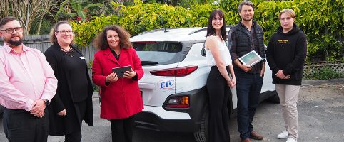 ETC staff with the human nature team the new car and ipads