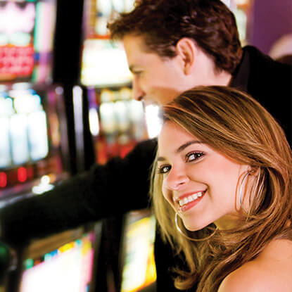 RCG couple at poker machine