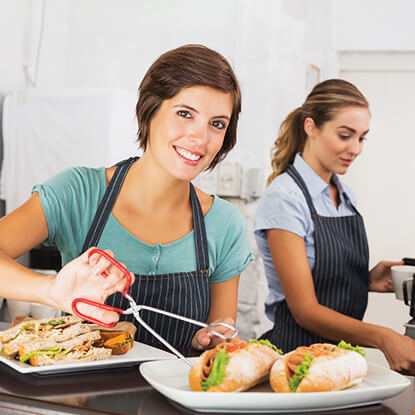 Safe food handling lady with sandwiches