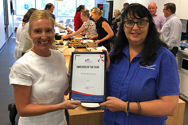 ISS Facility Services manager holding ETC's Employer of the Year certificate. Celebrating the bulk recruitment process used to hire over 100 staff.