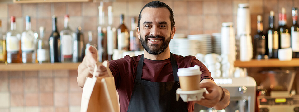 Man serving take away food and coffee